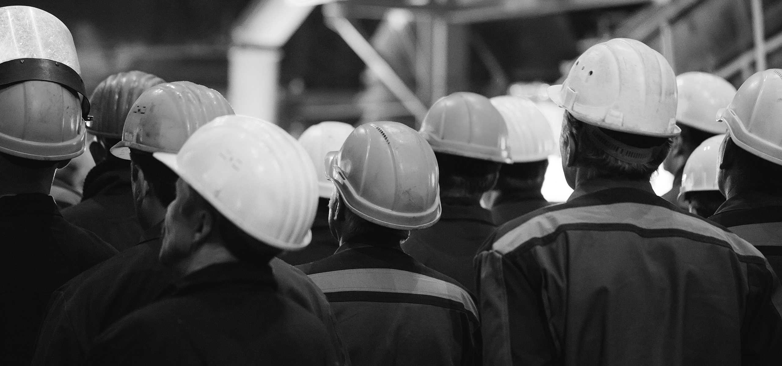 Image of a group of workers in hard hats.