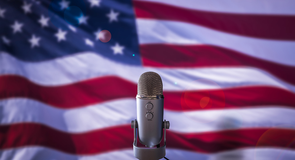 Image of the US flag and a microphone.